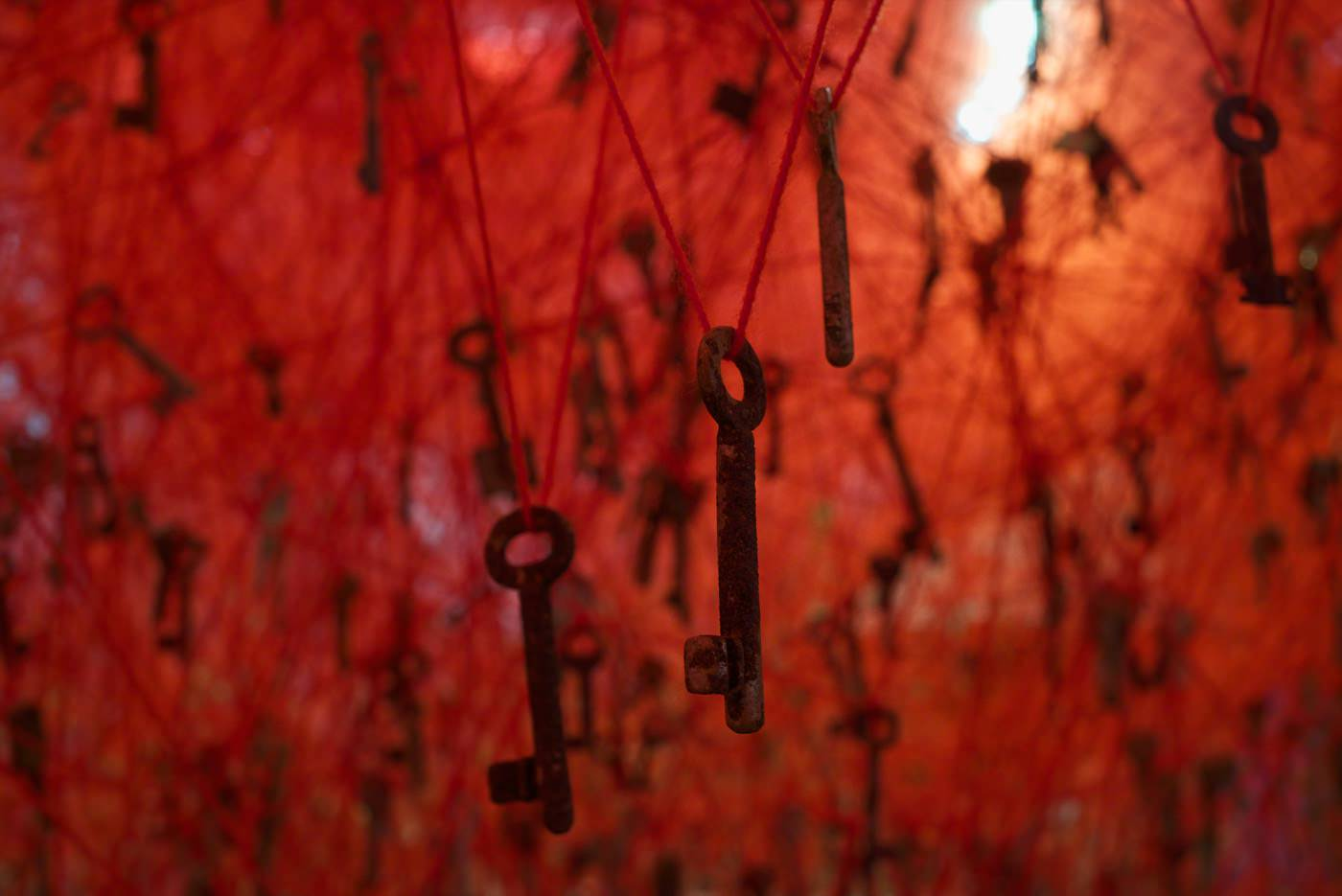 """The Key in the Hand"", 2015, Old keys, old wooden boats, red wool, Venice, Italy, photo by Sunhi Mang"